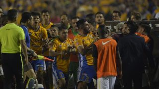 Players of Tigres and America fight during their 2016 Mexican Apertura tournament final football match at the Universitario stadium in Monterrey, Mexico on December 25, 2016.  / AFP PHOTO / Pedro Pardo