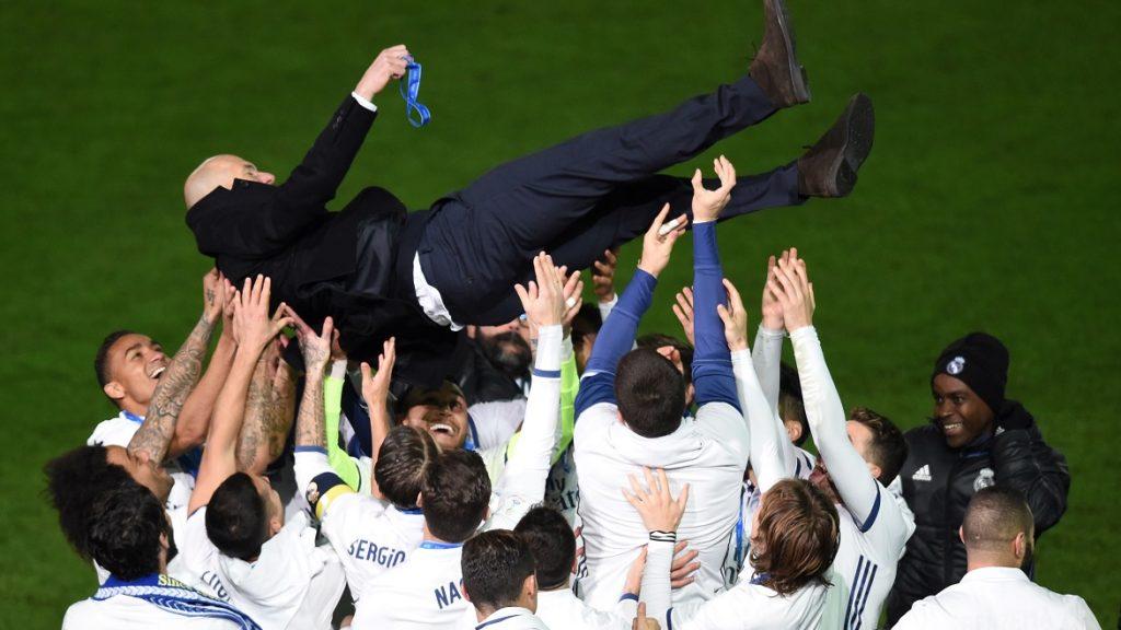 Real Madrid head coach Zinedine Zidane is thrown into the air by Real Madrid players after winning the Club World Cup football final match against Kashima Antlers of Japan at Yokohama International stadium in Yokohama on December 18, 2016. / AFP PHOTO / Toru YAMANAKA