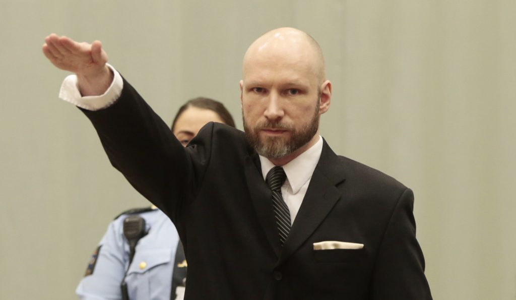"""Norwegian mass murder Anders Behring Breivik makes a Nazi salute ahead his appeal hearing at a court at the Telemark prison in Skien, Norway, on January 10, 2017. A Norway court begins examining the state's appeal against a ruling that it has treated mass murderer Anders Behring Breivik """"inhumanely"""" since he was jailed for killing 77 people in 2011. / AFP PHOTO / NTB Scanpix / Lise AASERUD / Norway OUT"""