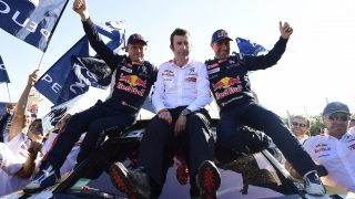 (from L to R) Peugeot's co-driver Jean Paul Cottret of France, team manager Bruno Famin and driver Stephane Peterhansel celebrate their victory at the end of the Stage 12 of the Dakar 2017 between Rio Cuarto and Buenos Aires, Argentina, on January 14, 2017.   France's Stephane Peterhansel won his 13th Dakar Rally title on Saturday, saying the latest win was the sweetest following an epic battle with French Peugeot teammate Sebastien Loeb. / AFP PHOTO / FRANCK FIFE