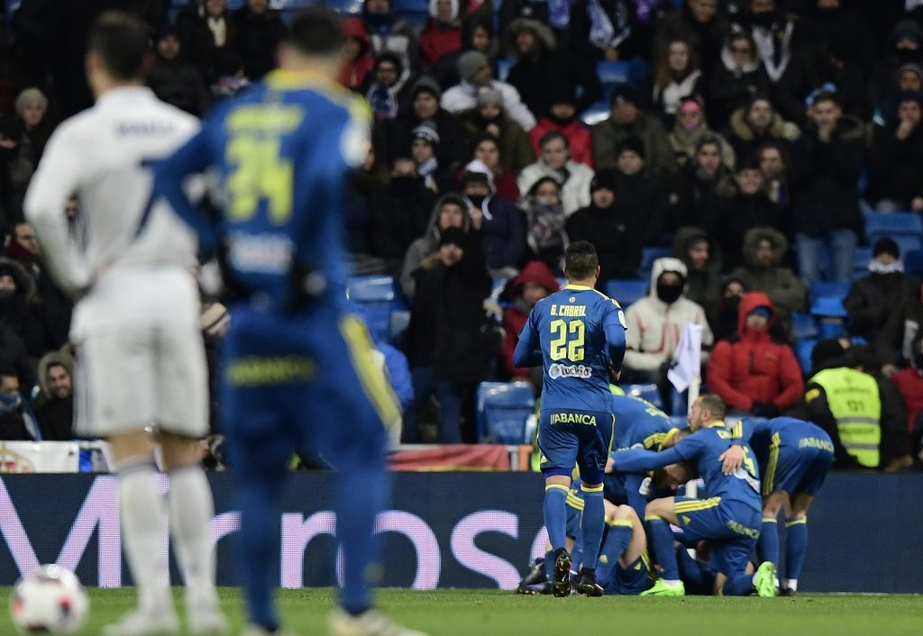 Celta Vigo players celebrate after scoring the opener during the Spanish Copa del Rey (King's Cup) quarter-final first leg football match Real Madrid CF vs RC Celta de Vigo at the Santiago Bernabeu stadium in Madrid on January 18, 2017. / AFP PHOTO / JAVIER SORIANO