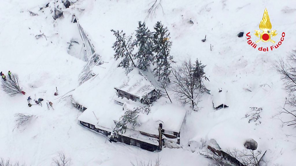 """This handout image obtained on the Vigili del Fuoco twitter account on January 19, 2017 shows an aerial view of the Hotel Rigopiano, near the village of Farindola, on the eastern lower slopes of the Gran Sasso mountain, engulfed by a powerful avalanche. Up to 30 people were feared to have died after an Italian mountain Hotel Rigopiano was engulfed by a powerful avalanche in the earthquake-ravaged centre of the country. Italy's Civil Protection agency confirmed the Hotel Rigopiano had been engulfed by a two-metre (six-feet) high wall of snow and that emergency services were struggling to get ambulances and diggers to the site.  / AFP PHOTO / Vigili del Fuoco / Handout / RESTRICTED TO EDITORIAL USE - MANDATORY CREDIT """"AFP PHOTO / VIGILI DEL FUOCO """" - NO MARKETING NO ADVERTISING CAMPAIGNS - DISTRIBUTED AS A SERVICE TO CLIENTS"""
