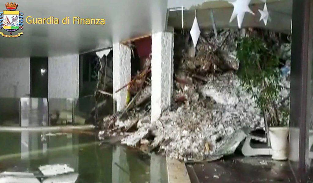 """This image grab made from a video handout released by the Guardia di Finanza on January 19, 2017 shows a wall of snow engulfing the inside of the Hotel Rigopiano, near the village of Farindola, on the eastern lower slopes of the Gran Sasso mountain. Up to 30 people were feared to have died after an Italian mountain Hotel Rigopiano was engulfed by a powerful avalanche in the earthquake-ravaged centre of the country. Italy's Civil Protection agency confirmed the Hotel Rigopiano had been engulfed by a two-metre (six-feet) high wall of snow and that emergency services were struggling to get ambulances and diggers to the site.  / AFP PHOTO / Guardia di Finanza press office / Handout / RESTRICTED TO EDITORIAL USE - MANDATORY CREDIT """"AFP PHOTO / GUARDIA DI FINANZA """" - NO MARKETING NO ADVERTISING CAMPAIGNS - DISTRIBUTED AS A SERVICE TO CLIENTS"""