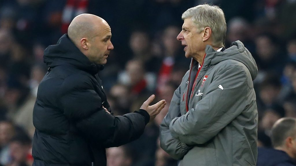 Fourth official Anthony Taylor (L) points Arsenal's French manager Arsene Wenger (R) to the tunnel after he was sent off by English referee Jonathan Moss (not pictured) during the English Premier League football match between Arsenal and Burnley at the Emirates Stadium in London on January 22, 2017.  Arsenal won the game 2-1. / AFP PHOTO / Ian KINGTON / RESTRICTED TO EDITORIAL USE. No use with unauthorized audio, video, data, fixture lists, club/league logos or 'live' services. Online in-match use limited to 75 images, no video emulation. No use in betting, games or single club/league/player publications.  /