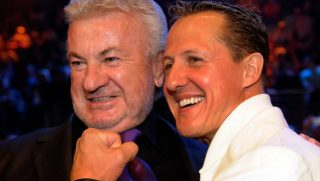 Seven time drivers champion and Ferrari team advisor Michael Schumacher (R) and his former manager Willi Weber attend the WBA middleweight world championship boxing match between German boxer Felix Sturm and Armenian-born German Khoren Gevor at the Nurburgring racetrack on July 11, 2009 in the western German town of Nurburg. Sturm won the fight on points and remains World Champion. AFP PHOTO / SASCHA SCHUERMANN  GERMANY