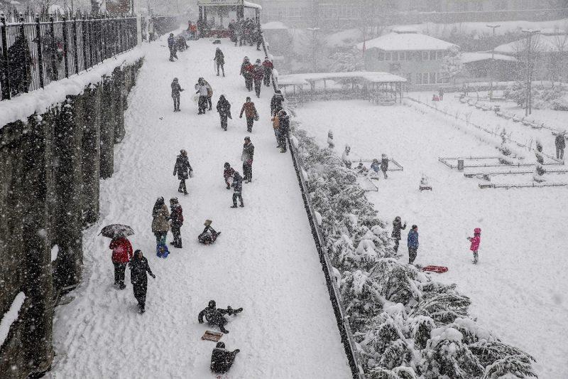 ISTANBUL, TURKEY - JANUARY 9: People enjoy the snow during heavy snowfall at Fatih district of Istanbul, Turkey on January 9, 2017.   Arif Hudaverdi Yaman / Anadolu Agency