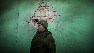 Soldier of the Donetsk People´s Republic inside a shelled building close to the frontline of Zaitseve, Ukraine, on January 7, 2017. (Photo by Celestino Arce/NurPhoto)