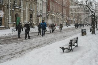 People walking at the covered by snow Gdansk old town are seen. Heavy snow fall, and frost hits northern Poland city of Gdansk on 6 January 2017. Low temperature close to minus 10 Celsius degrees and snow paralyzes road traffic in the region.  (Photo by Michal Fludra/NurPhoto)