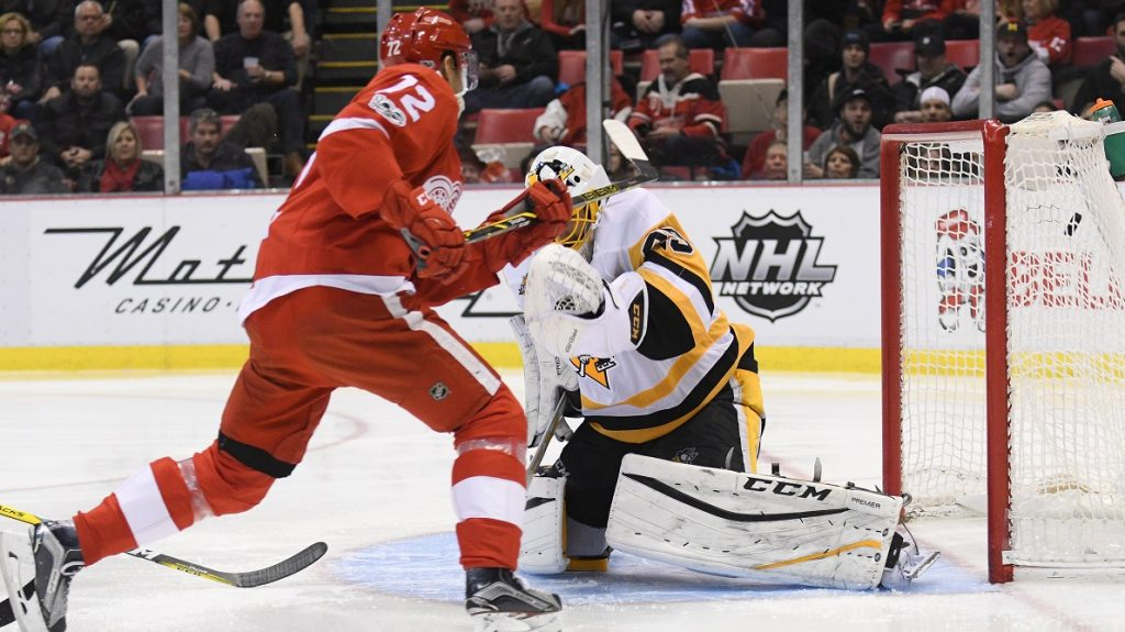 DETROIT, MI - JANUARY 14: Detroit Red Wings center Andreas Athanasiou (72) skates up ice to score on a breakaway during the NHL hockey game between the Pittsburgh Penguins and Detroit Red Wings on January 14, 2017, at Comerica Park in Detroit, Michigan.  (Photo by Steven King/Icon Sportswire via Getty Images)