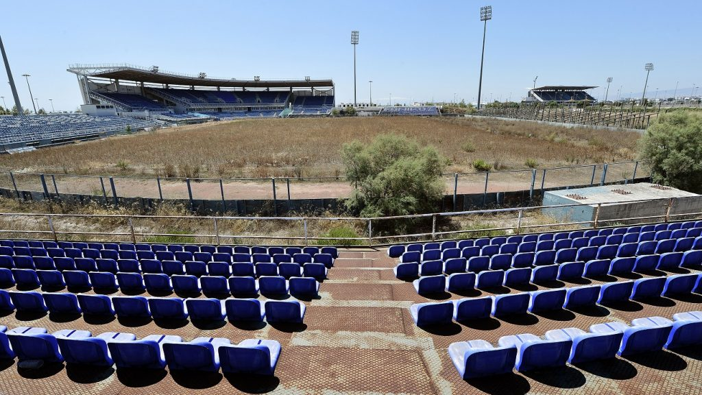 """ATHENS, GREECE - JULY 31: General view of the Olympic Baseball Stadium at the Helliniko Olympic complex in Athens, Greece on July 31, 2014. Ten years ago the XXVIII Olympiad was held in Athens from the 13th - 29th August with the motto """"Welcome Home"""". The cost of hosting the games was estimated to be approx 9 billion euros with the majority of sporting venues built specifically for the games. Due to Greece's economic frailties post Olympic Games there has been no further investment and the majority of the newly constructed stadiums now lie abandoned. (Photo by Milos Bicanski/Getty Images)"""