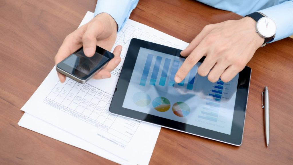 Young businessman working with modern devices.