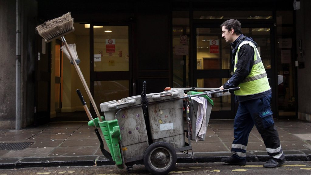 BATH, ENGLAND - JANUARY 18:  A street cleaner passes the Jobcentre Plus office on January 18, 2012 in Bath, England. Figures released today show that the UK unemployment rate has risen to a 17-year high increasing by 118,000 in the three months between September and November, taking the total jobless count to 2.685 million.  (Photo by Matt Cardy/Getty Images)