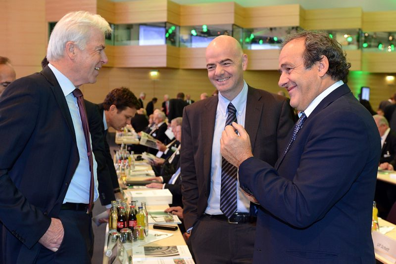 NUREMBERG, GERMANY - OCTOBER 25:  Rainer Holzschuh, publisher of the Kicker Sportmagazin, talks to UEFA president Michel Platini and UEFA general secretary Giovanni Infantino during the DFB Bundestag at NCC Nuremberg on October 25, 2013 in Nuremberg, Germany.  (Photo by Lars Baron/Bongarts/Getty Images)