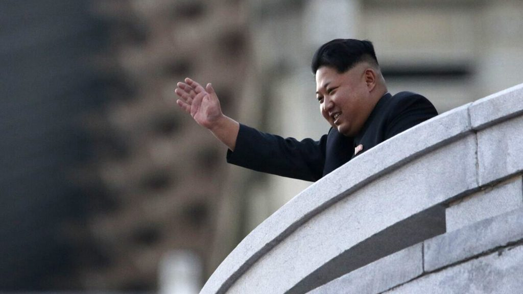 PYONGYANG, NORTH KOREA - OCTOBER 10: (CHINA OUT) North Korea's leader Kim Jong-Un waves from a balcony towards participants of a mass military parade at Kim Il-Sung square to mark the 70th anniversary of its ruling Worker's Party of Korea on October 10, 2015 in Pyongyang, North Korea.  (Photo by Liu Xingzhe/VCG via Getty Images)