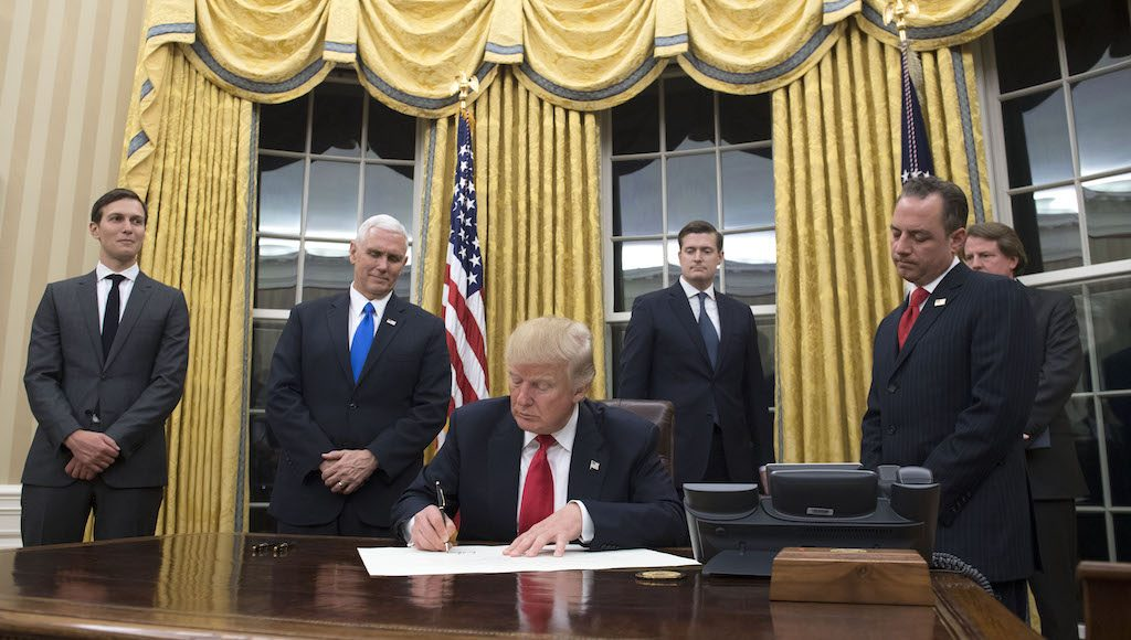 WASHINGTON, DC - JANUARY 20: President Donald Trump prepares to sign a confirmation for Homeland Security Secretary James Kelly, in the Oval Office at the White House in Washington, D.C. on January 20, 2017.  (Photo by Kevin Dietsch - Pool/Getty Images)