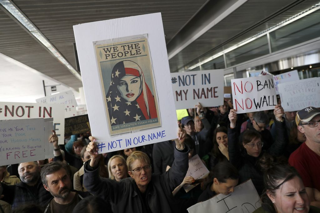 SAN FRANCISCO, CA - JANUARY 28: Demonstrators hold signs during a rally against a ban on Muslim immigration at San Francisco International Airport on January 28, 2017 in San Francisco, California. President Donald Trump signed an executive order Friday that suspends entry of all refugees for 120 days, indefinitely suspends the entries of all Syrian refugees, as well as barring entries from seven predominantly Muslim countries from entering for 90 days. (Photo by Stephen Lam/Getty Images)