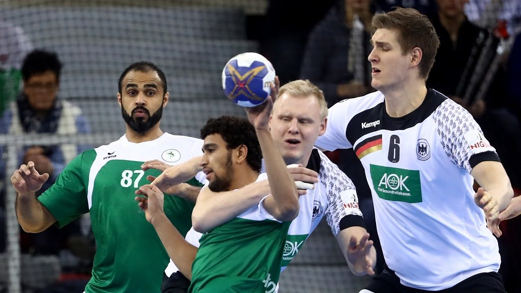 ROUEN, FRANCE - JANUARY 17: Patrick Wienczek (C) of Germany challenges Abdullah Alhammad (L) of Saudi Arabia during the 25th IHF Men's World Championship 2017 match between Germany and Saudi Arabia at Kindarena on January 17, 2017 in Rouen, France.  (Photo by Alex Grimm/Bongarts/Getty Images)