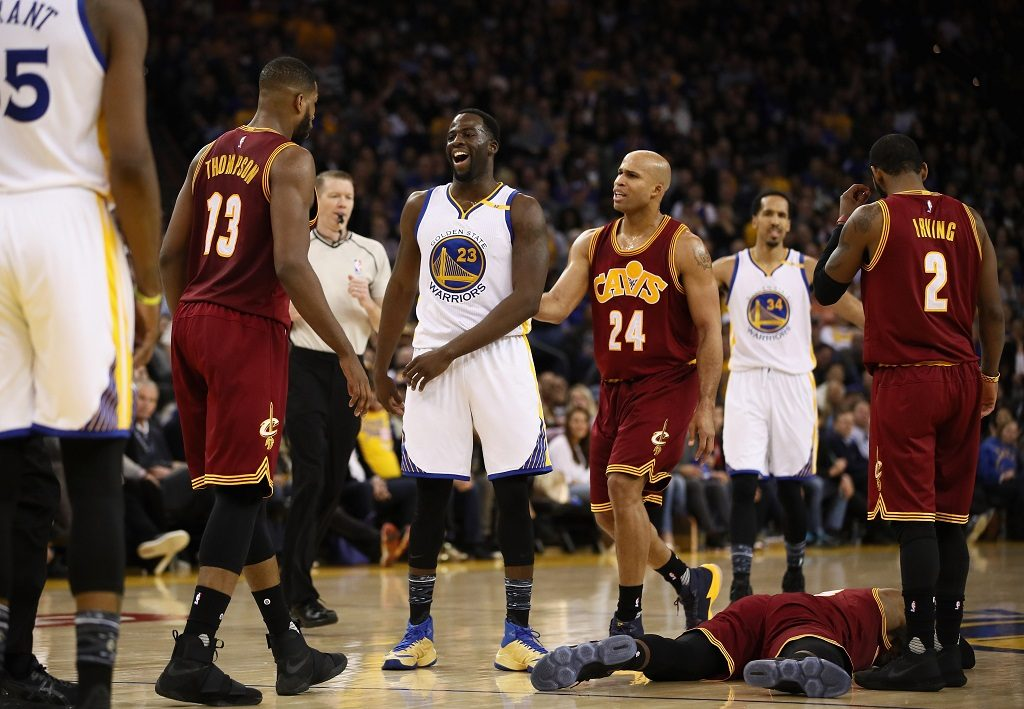 OAKLAND, CA - JANUARY 16: Draymond Green #23 of the Golden State Warriors reacts after he fouled LeBron James #23 of the Cleveland Cavaliers at ORACLE Arena on January 16, 2017 in Oakland, California. NOTE TO USER: User expressly acknowledges and agrees that, by downloading and or using this photograph, User is consenting to the terms and conditions of the Getty Images License Agreement.   Ezra Shaw/Getty Images/AFP