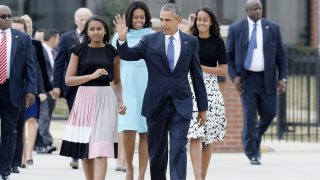 JOINT BASE ANDREWS, MD - SEPTEMBER 22:   (AFP OUT) U.S. President Barack Obama, daughters Sasha and Malia, and first lady Michelle Obama arrive to greet the Pope September 22, 2015 at Joint Base Andrews, Maryland. Francis will be visiting Washington, New York City and Philadelphia during his first trip to the United States as Pope.  (Photo by Olivier Douliery-Pool/Getty Images)