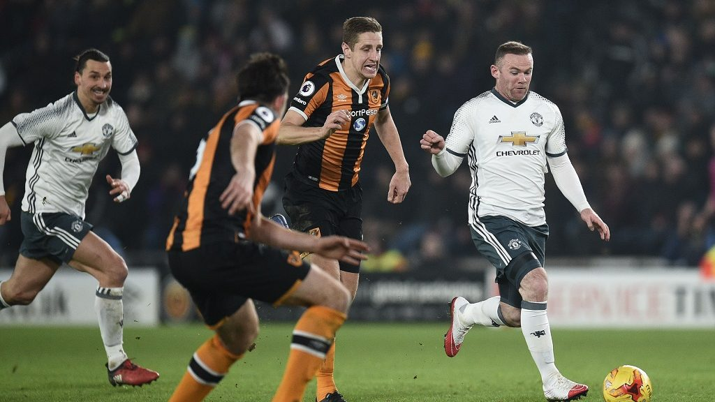 Manchester United's English striker Wayne Rooney (R) runs with the ball during the EFL (English Football League) Cup semi-final second-leg football match between Hull City and Manchester United at the KCOM Stadium in Kingston upon Hull, north east England on January 26, 2017.   / AFP PHOTO / Oli SCARFF / RESTRICTED TO EDITORIAL USE. No use with unauthorized audio, video, data, fixture lists, club/league logos or 'live' services. Online in-match use limited to 75 images, no video emulation. No use in betting, games or single club/league/player publications.  /