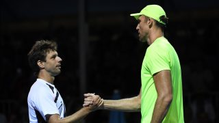 Croatia's Ivo Karlovic (R) shakes hands with Argentina's Horacio Zeballos after winning their men's singles match on day two of the Australian Open tennis tournament in Melbourne on January 17, 2017. / AFP PHOTO / SAEED KHAN / IMAGE RESTRICTED TO EDITORIAL USE - STRICTLY NO COMMERCIAL USE