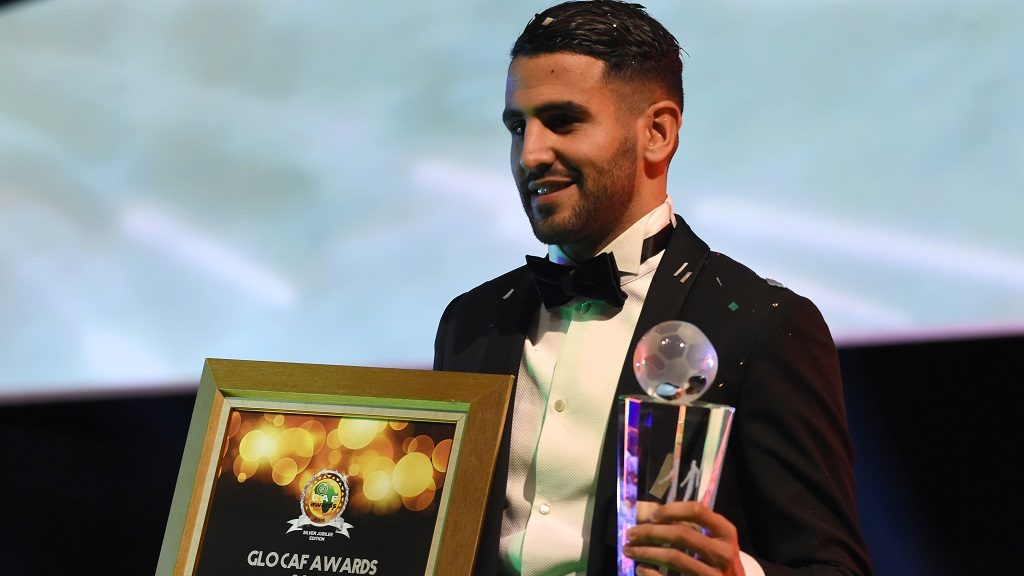 Algerian and Leicester forward Riyad Mahrez poses for a photo after being crowned African Footballer of the Year in Abuja, on January 5, 2017.  Algerian and Leicester striker Riyad Mahrez has been crowned the CAF African best Footballer for 2016 and beating former best player and Gabonese forward Pierre-Emerick  Aubameyang  and Sehegalese striker Sadio Mane, for the continent's most prestigious individual award. / AFP PHOTO / PIUS UTOMI EKPEI