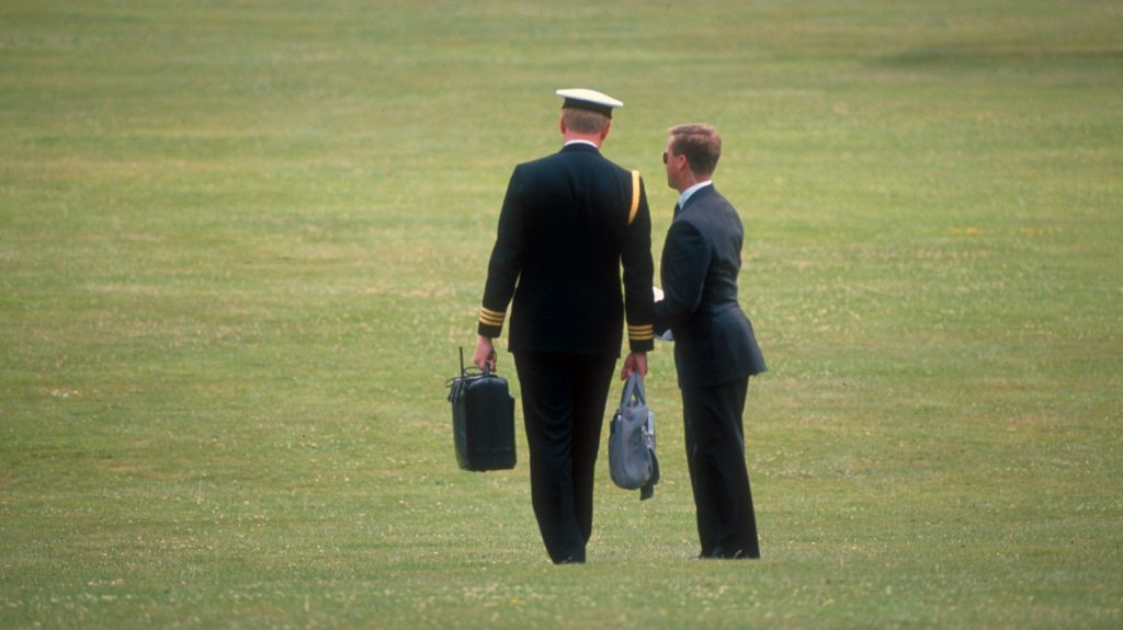 """TEXAS, UNITED STATES - JULY 09:  """"Football carrier"""" (military aide with briefcase containing nuclear missile launching code), heading for copter to be near President Bush during Houston, TX Economic Summit.  (Photo by Diana Walker/Time & Life Pictures/Getty Images)"""