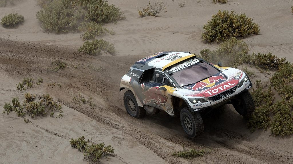 Peugeot's driver Stephane Peterhansel and his co-driver Jean Paul Cottret of France compete during Stage 5 of the 2017 Dakar Rally between Tupiza and Oruro, Bolivia, on January 6, 2017. / AFP PHOTO / Franck FIFE