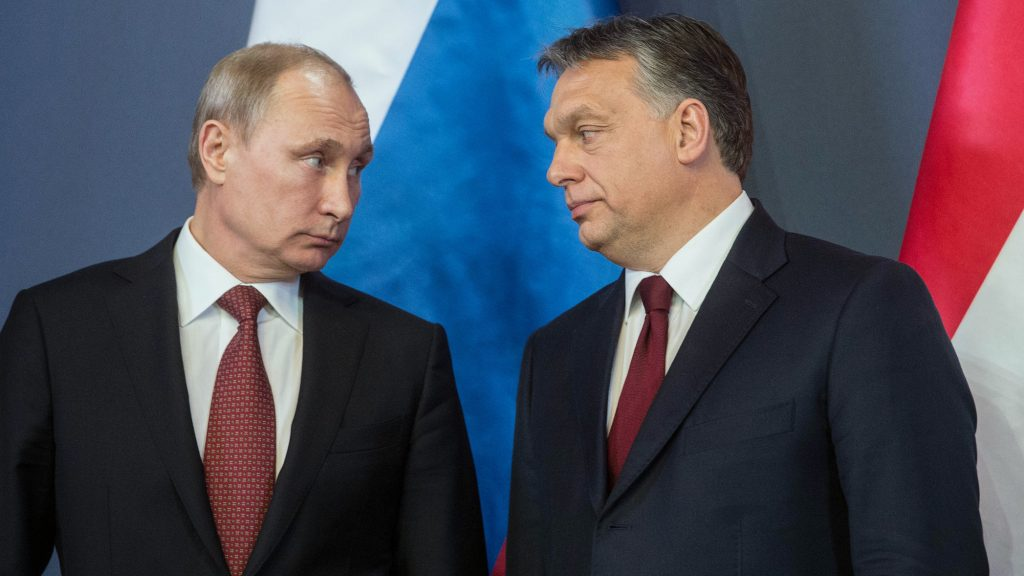 """A handout photo provided by the Hungarian prime minister's office shows Russian President Vladimir Putin (L) and Hungarian Prime Minister Viktor Orban (R) posing in front of their national flags at the parliament in Budapest on February 17, 2015 prior to their joint press conference. Putin was on a one-day visit to Hungary. AFP PHOTO / PRIME MINISTER OFFICE / GERGELY BOTAR  RESTRICTED TO EDITORIAL USE - MANDATORY CREDIT """"AFP PHOTO / PRIME MINISTER OFFICE / GERGELY BOTAR"""" - NO MARKETING NO ADVERTISING CAMPAIGNS - DISTRIBUTED AS A SERVICE TO CLIENTS / AFP PHOTO / PRIME MINISTER OFFICE / GERGELY BOTAR"""