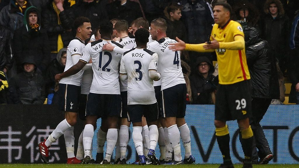Tottenham Hotspur's English midfielder Dele Alli (L) and teammates mob Tottenham Hotspur's English striker Harry Kane after he scores his team's first goal during the English Premier League football match between Watford and Tottenham Hotspur at Vicarage Road Stadium in Watford, north of London on January 1, 2017. / AFP PHOTO / Adrian DENNIS / RESTRICTED TO EDITORIAL USE. No use with unauthorized audio, video, data, fixture lists, club/league logos or 'live' services. Online in-match use limited to 75 images, no video emulation. No use in betting, games or single club/league/player publications.  /