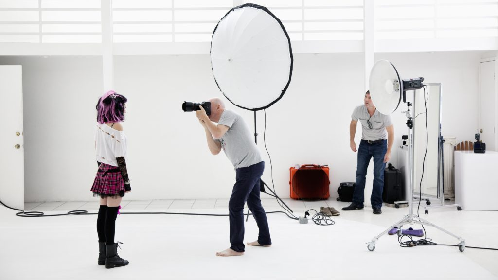 Photographer shooting fashion model in photo shoot