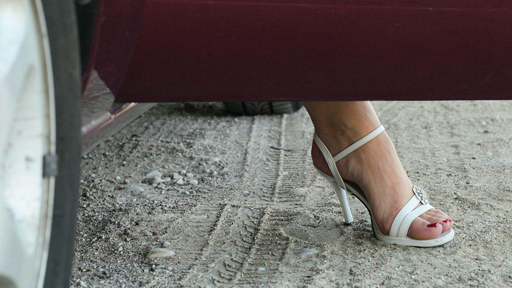 woman leg  on a road