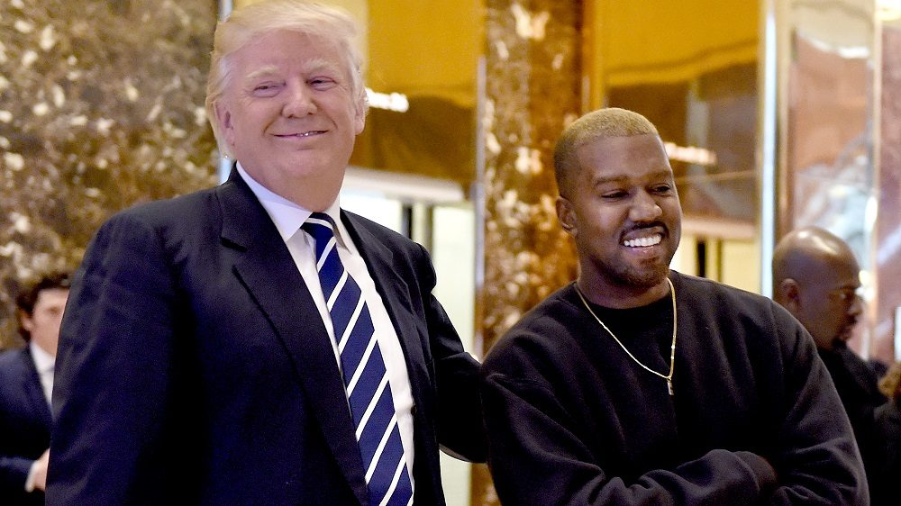 Singer Kanye West and President-elect Donald Trump speak with the press after their meetings at Trump Tower December 13, 2016 in New York. / AFP PHOTO / TIMOTHY A. CLARY
