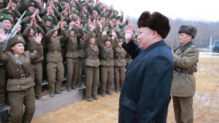 """This undated picture released from North Korea's official Korean Central News Agency (KCNA) on January 19, 2017 shows North Korean leader Kim Jong-Un (2nd R) inspecting a sub-unit under KPA Unit 233 at an undisclosed location. North Korea is preparing to test new rockets, a report said on January 19, after its leader Kim Jong-Un said the country was in the final stages of developing inter-continental ballistic missiles. / AFP PHOTO / KCNA VIA KNS / STR / South Korea OUT / REPUBLIC OF KOREA OUT   ---EDITORS NOTE--- RESTRICTED TO EDITORIAL USE - MANDATORY CREDIT """"AFP PHOTO/KCNA VIA KNS"""" - NO MARKETING NO ADVERTISING CAMPAIGNS - DISTRIBUTED AS A SERVICE TO CLIENTS THIS PICTURE WAS MADE AVAILABLE BY A THIRD PARTY. AFP CAN NOT INDEPENDENTLY VERIFY THE AUTHENTICITY, LOCATION, DATE AND CONTENT OF THIS IMAGE. THIS PHOTO IS DISTRIBUTED EXACTLY AS RECEIVED BY AFP.  /"""