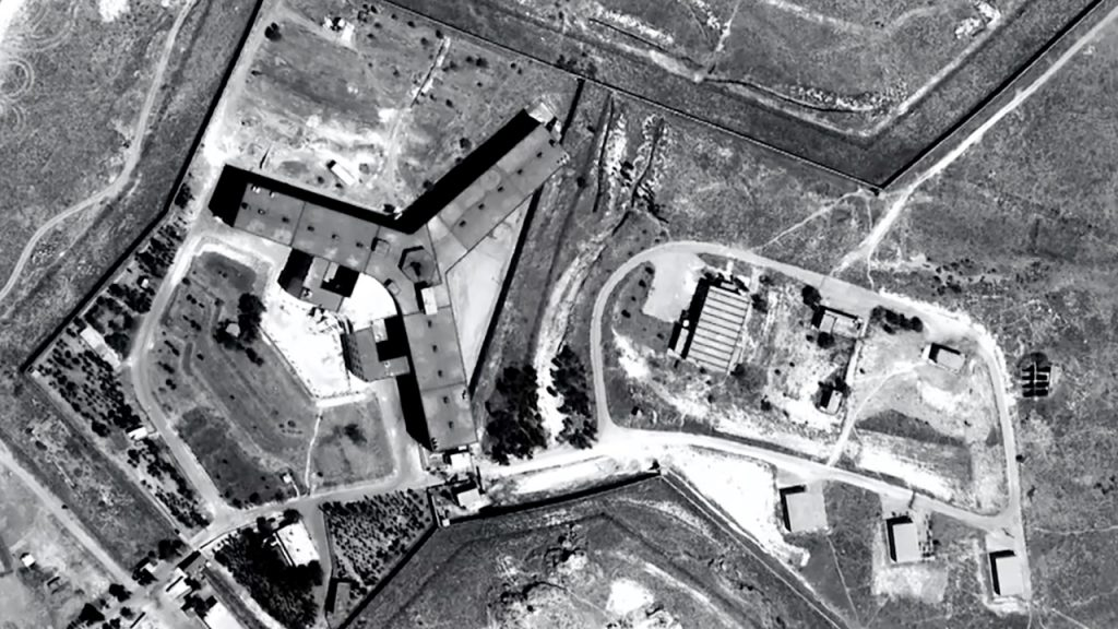 """A handout satellite image released on February 7, 2017 by Amnesty International shows the military-run Saydnaya prison, one of Syria's largest detention centres located 30 kilometres (18 miles) north of Damascus.   As many as 13,000 people were hanged in five years at the notorious Syrian government prison near Damascus, Amnesty International said on February 7, 2017, accusing the regime of a """"policy of extermination.""""    / AFP PHOTO / AFP / Handout"""