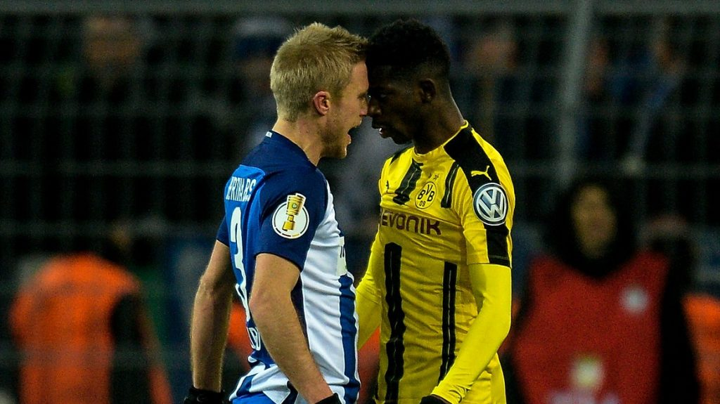 Dortmund's French midfielder Ousmane Dembele and Berlin's Norwegian midfielder Per Ciljan Skjelbred go head to head during the German Cup DFB Pokal round of 16 football match BVB Borussia Dortmund v Hertha Berlin in Dortmund, western Germany on February 8, 2017. / AFP PHOTO / SASCHA SCHUERMANN / RESTRICTIONS: ACCORDING TO DFB RULES IMAGE SEQUENCES TO SIMULATE VIDEO IS NOT ALLOWED DURING MATCH TIME. MOBILE (MMS) USE IS NOT ALLOWED DURING AND FOR FURTHER TWO HOURS AFTER THE MATCH. == RESTRICTED TO EDITORIAL USE == FOR MORE INFORMATION CONTACT DFB DIRECTLY AT +49 69 67880   /