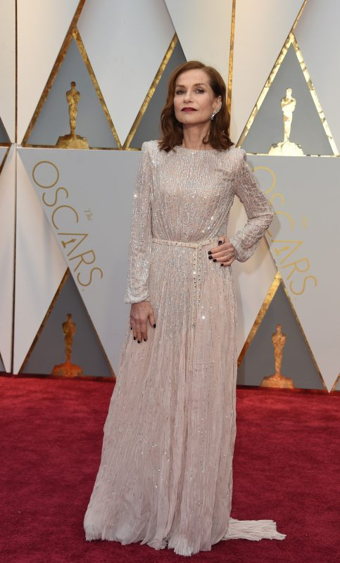 """Nominee for Best Actress """"Elle"""" Isabelle Huppert arrives on the red carpet for the 89th Oscars on February 26, 2017 in Hollywood, California.  / AFP PHOTO / VALERIE MACON"""