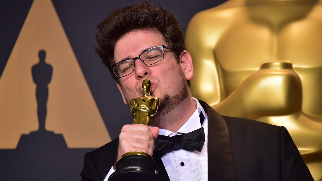 """Director Kristof Deak poses in the press room with his Best Live Action Short Film award for """"Sing"""" during the 89th Annual Academy Awards February 26, 2017 in Hollywood, California.    / AFP PHOTO / FREDERIC J. BROWN"""