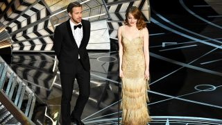 HOLLYWOOD, CA - FEBRUARY 26: Actors Ryan Gosling (L) and Emma Stone walk onstage during the 89th Annual Academy Awards at Hollywood & Highland Center on February 26, 2017 in Hollywood, California.   Kevin Winter/Getty Images/AFP