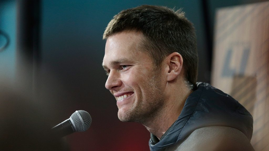 HOUSTON, TX - JANUARY 30: Tom Brady #12 of the New England Patriots reacts as he speaks with the media during Super Bowl 51 Opening Night at Minute Maid Park on January 30, 2017 in Houston, Texas.   Bob Levey/Getty Images/AFP