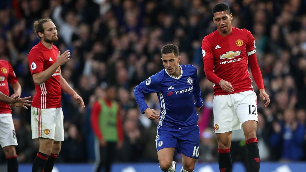 Chelsea's Eden Hazard (centre) celebrates scoring his side's third goal as Manchester United's Chris Smalling (right) and Daley Blind look on (Photo by Nick Potts/PA Images via Getty Images)