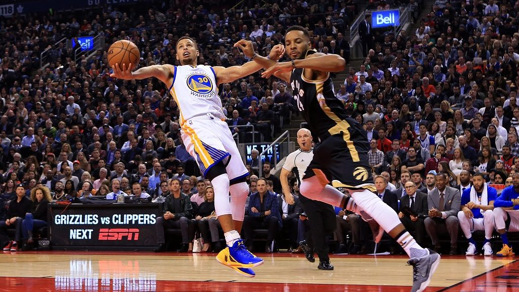 TORONTO, ON - NOVEMBER 16: Steph Curry #30 of the Golden State Warriors shoots the ball as Norman Powell #24 of the Toronto Raptors defends during the first half of an NBA game at Air Canada Centre on November 16, 2016 in Toronto, Canada. NOTE TO USER: User expressly acknowledges and agrees that, by downloading and or using this photograph, User is consenting to the terms and conditions of the Getty Images License Agreement.   Vaughn Ridley/Getty Images/AFP
