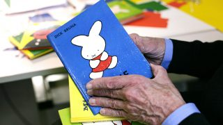 Dick Bruna, author of the Miffy books, artist, illustrator and graphic designer, opeining one of his books in his studio, Utrecht, The Netherlands, 2nd October 2010. (Photo by Martin Godwin/Getty Images)