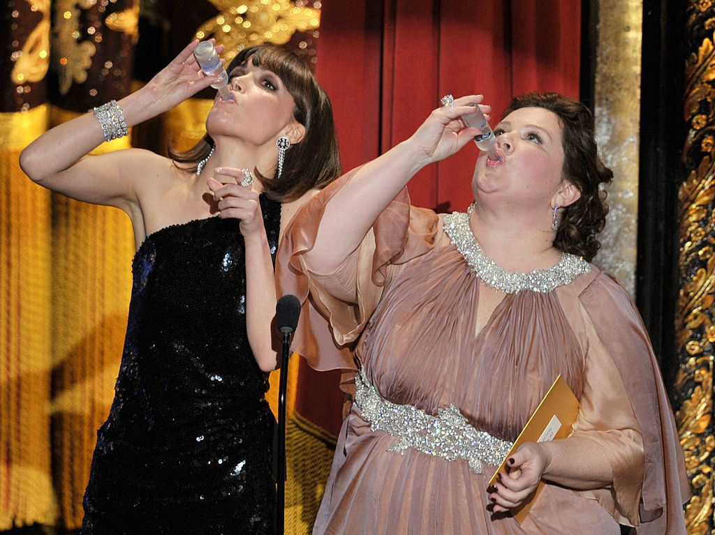 HOLLYWOOD, CA - FEBRUARY 26:  Presenters Rose Byrne (L) and Melissa McCarthy speak onstage during the 84th Annual Academy Awards held at the Hollywood & Highland Center on February 26, 2012 in Hollywood, California.  (Photo by Kevin Winter/Getty Images)