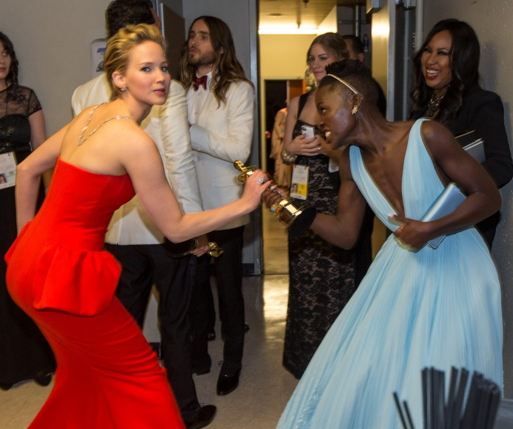 HOLLYWOOD, CA - MARCH 02:  Actresses Jennifer Lawrence (L) and Lupita Nyong'o backstage during the Oscars held at Dolby Theatre on March 2, 2014 in Hollywood, California.  (Photo by Christopher Polk/Getty Images)