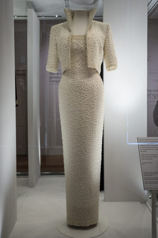 """LONDON, ENGLAND - FEBRUARY 22: A 1989 Catherine Walker dress and jacket dress embroidered with sequins and pearls, known as the """"Elvis Dress"""", worn by Princess Diana on an official visit to Hong Kong in 1989 on display at a press preview at Kensington Palace on February 22, 2017 in London, England. The exhibition 'Diana: Her Fashion Story', which showcases a number of the Princess' dresses and outfits, opens to the public on February 24 as part of events commemorating the life of Princess Diana to mark the 20th anniversary of her death in Paris on August 31st, 1997.  (Photo by Jack Taylor/Getty Images)"""