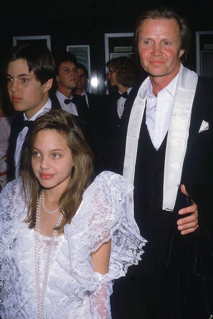 American actor Jon Voight (right) attends the Academy Awards with his son James Haven Voight (left) and daughter Angelina Jolie Voight, at the Dorothy Chandler Pavilion, Los Angeles, California, March 24, 1986. (Photo by Bob Scott/Fotos International/Getty Images)