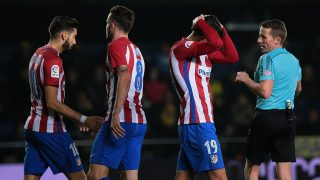 """Atletico Madrid's French defender Lucas Hernandez (R) gestures after missing an attempt on goal during the Spanish league football match Villarreal CF vs Club Atletico de Madrid at El Madrigal stadium in Vila-real on December 12, 2016. / AFP PHOTO / Jose Jordan / """"The BYLINE  of this photo by JOSE JORDAN  has been modified in AFP systems in the following manner: [Jose Jordan] instead of [Antonio del Toro]. Please immediately remove the erroneous mention[s] from all your online services and delete it (them) from your servers. If you have been authorized by AFP to distribute it (them) to third parties, please ensure that the same actions are carried out by them. Failure to promptly comply with these instructions will entail liability on your part for any continued or post notification usage. Therefore we thank you very much for all your attention and prompt action. We are sorry for the inconvenience this notification may cause and remain at your disposal for any further information you may require."""""""