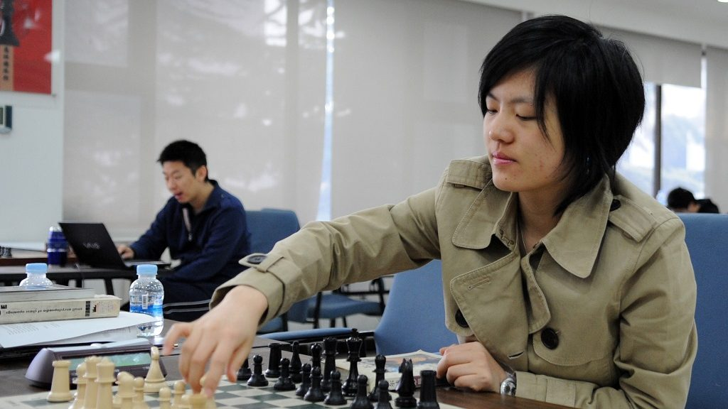 (120221) -- BEIJING, Feb. 21, 2012 (Xinhua) -- Hou Yifan, the reigning Women's World Chess Champion, the youngest ever to win the title, attends a training session in Beijing, China, on Feb. 14, 2012.       Hou was born in east China's Jiangsu Province in 1994. She learnt chess at the age of 5 and a half and entered China's national team at the age of 9. In 2007, Hou became China's youngest National Women's Champion ever. She achieved Woman Grandmaster in 2007, and Grandmaster in 2009. In 2010, she became the youngest World Chess Champion in history by winning the Women's World Championship in Turkey, and she defended her title in Albania in 2011.     Hou lists her hobbies as reading, swimming and listening to music, together with many other interests.     Hou says that one of her plans is to challenge men chess players in the future and the other is to pursue higher eudcation in a college one day.     (Xinhua/Jia Yuchen) (hy)