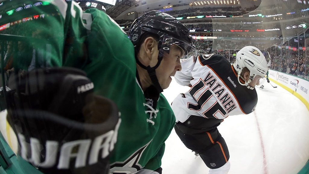 DALLAS, TX - DECEMBER 13: Jiri Hudler #22 of the Dallas Stars skates for the puck against Sami Vatanen #45 of the Anaheim Ducks in the first period at American Airlines Center on December 13, 2016 in Dallas, Texas.   Ronald Martinez/Getty Images/AFP
